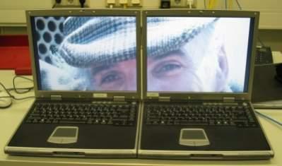 Obraz dzielony między laptopa z Linuksem (po lewej) i Windows XP (źródło: LinuxDevices)